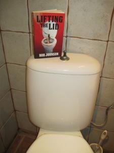 Paperback on toilet